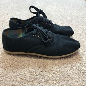 Black lace up Toms