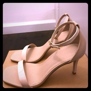 Nude strap high heel.
