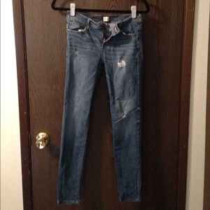 Distressed skinny blue jeans