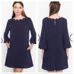 Navy Scalloped dress with bell sleeves
