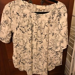 White and black floral swing top loft