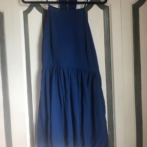 Navy skater dress with cut out back and pockets