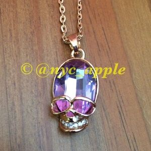 🆕 Rose Colored Glass Skull Necklace