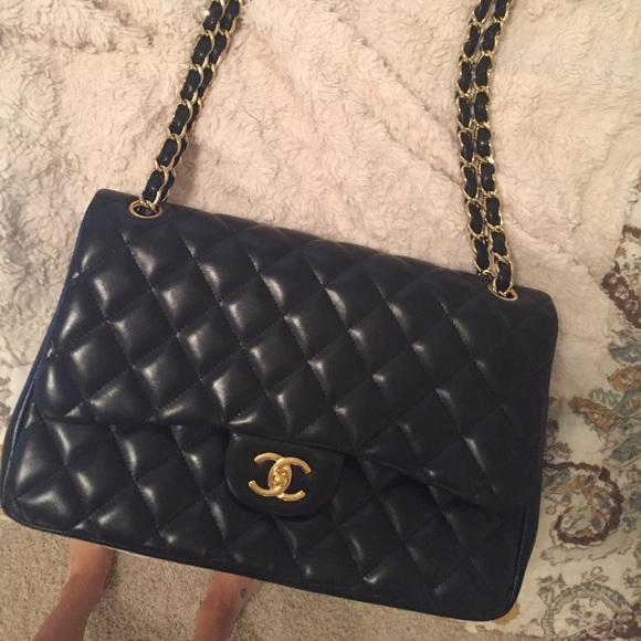 5e899e80bef7 CHANEL Handbags - CHANEL quilted jumbo flap bag - black