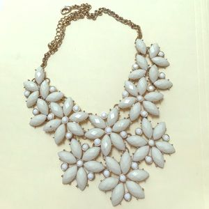 Chunky gold and white flower embellished necklace