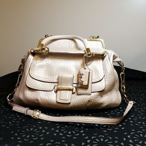 Coach pink pearlized purse