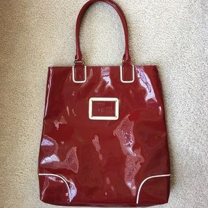 Estée Lauder red patent tote with cosmetic bag