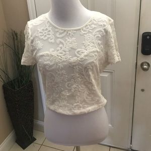 White lace crop top with a floral design