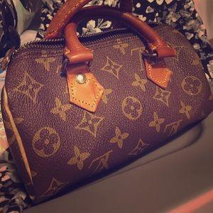 Vintage mini Louis Vuitton purse