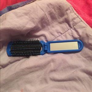 Blue and black foldable brush