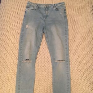 High waist rip knee jeans.