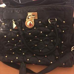 Studded black Michael kors bag