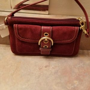 Coach suede clutch never used