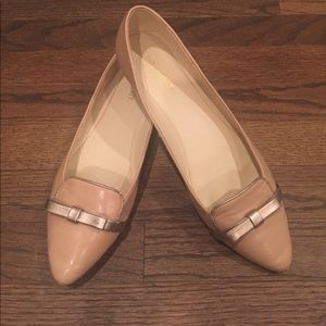 Nine West tan flats; size 9.5. Gold bow detail.