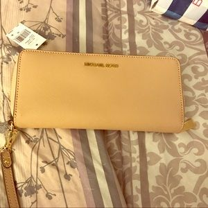 Brand new authentic MK wristlet from Macy's !