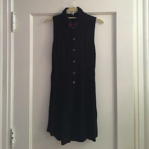 Black sleeveless dress with embroidered collar