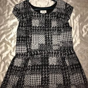 A black and white pattern dress