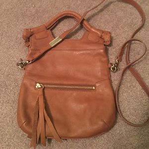 Brown leather fold over Foley and Corinna purse