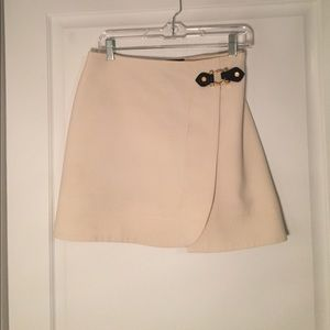 A mini skirt with buckle detailing