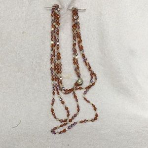 Irredescent brown/ clear double strand necklace
