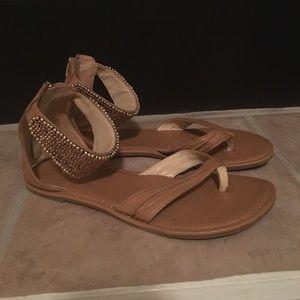 Gold Fergie flat sandals sz 9.5