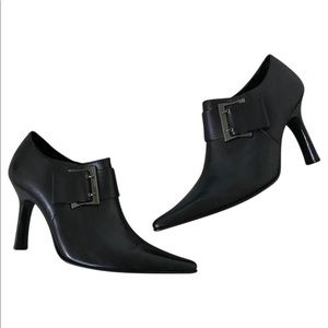 Black leather ankle booties with buckle