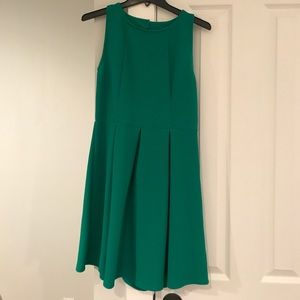 Emerald green fit and flare dress.