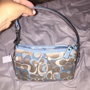 Brand new blue Coach bag with tags