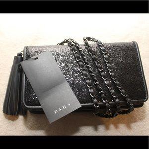Zara pocket book with chain strap