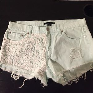 Laced turquoise shorts