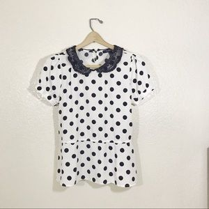 Polka dot peplum top with Peter Pan collar.