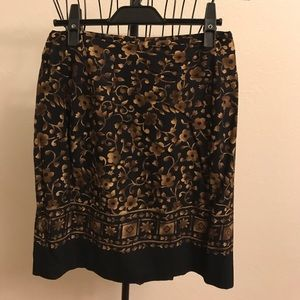Black and gold floral mini skirt