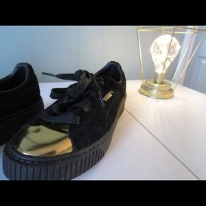 Puma black and gold suede platform sneakers