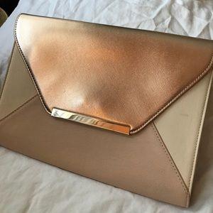 Express oversized rose gold envelope clutch