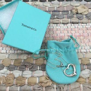 Tiffany and Co. necklace open heart Elsa Peretti.
