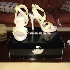 Strappy nude heels with a bright neon yellow trim.