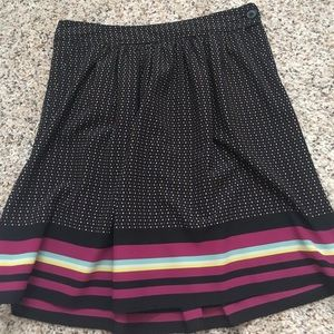 Black skirt with stripes and polka dots.
