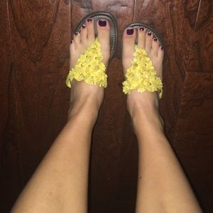 Yellow flower flip flops