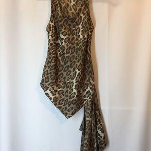 Diane van Furstenberg, Leopard shell, size 6.   b