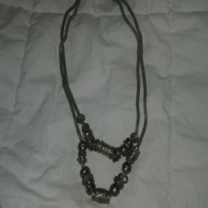 Ladies necklace with silver and brass colors