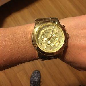 Michael kors. Gold watch. Large face. Unisex.