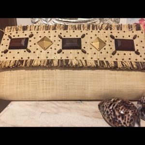 Ratan clutch bag with beaded detail
