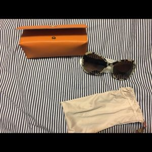 Tory Burch black and cream tortoise sunglasses.