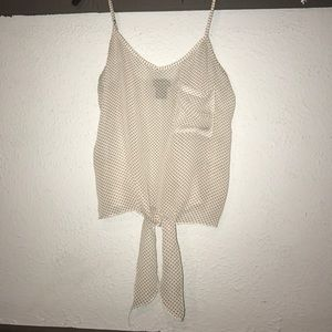 Sheer tie in front tank with left pocket detail