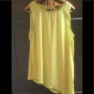 Bright green assymetrical sleeveless blouse.