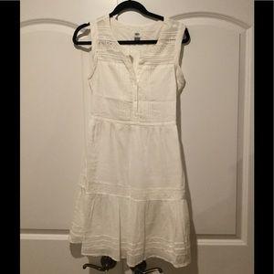 Tiered white cotton dress.