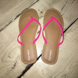 Hot pink Old Navy flip flops.