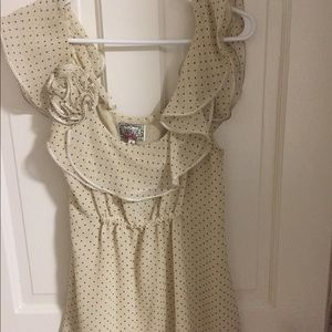 Anthropologie polka dot top with rosette