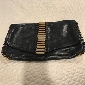 Ted Baker black leather clutch with gold hardware