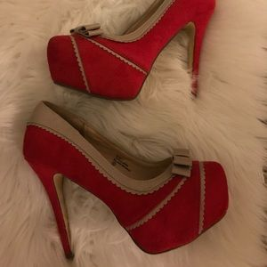 Tan and red pumps